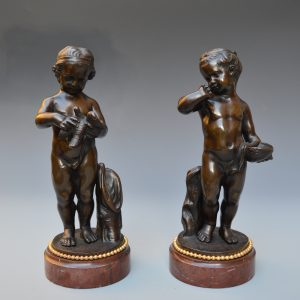 PAIR OF PATINATED ANTIQUE BRONZE FIGURES OF PUTTI