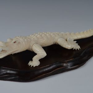 ANTIQUE CARVED IVORY CROCODILE ON WOODEN BASE