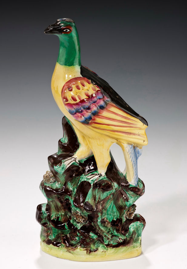 ANTIQUE STAFFORDSHIRE FIGURE OF A BIRD