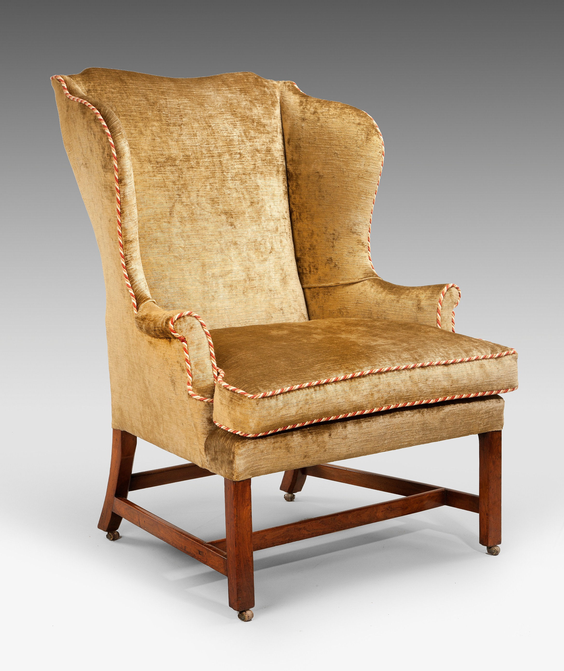 ANTIQUE GEORGE III WALNUT WING ARMCHAIR ON CHAMFER LEGS