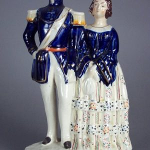 ANTIQUE STAFFORDSHIRE FIGURE OF PRINCESS ROYAL WITH PRINCE FREDERICK WILLIAM