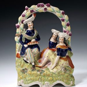 ANTIQUE STAFFORDSHIRE FIGURE OF CHANG AND ENG BUNKER