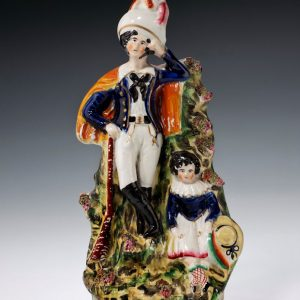 ANTIQUE STAFFORDSHIRE FIGURE OF HUNTER AND CHILD