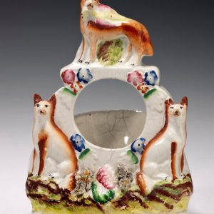 ANTIQUE STAFFORDSHIRE FIGURE OF A GROUP OF FOXES