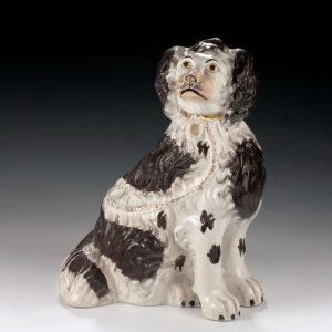 ANTIQUE STAFFORDSHIRE FIGURE OF A SPANIEL