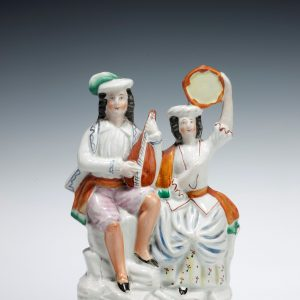 ANTIQUE STAFFORDSHIRE FIGURE OF A PAIR OF MUSICIANS