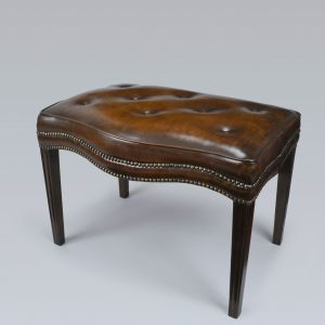 GEORGE III MAHOGANY AND BUTTONED HIDE WINDOW SEAT