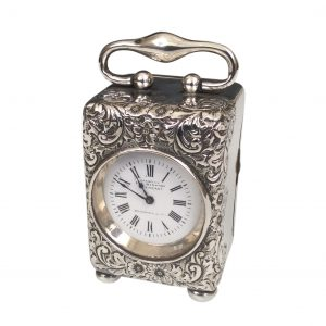 ANTIQUE SILVER AND SILVER GILT CARRIAGE CLOCK