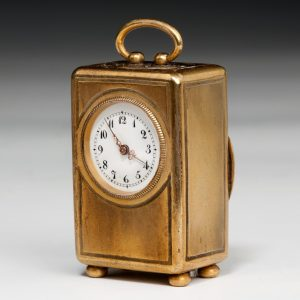 ANTIQUE GILT BRONZE SUBMINIATURE CARRIAGE OR BOUDOIR CLOCK