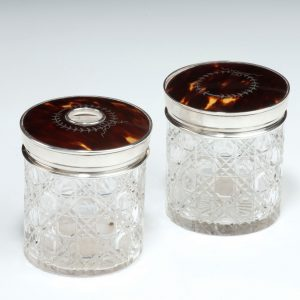 ANTIQUE PAIR CUT GLASS SILVER AND TORTOISESHELL DRESSING TABLE JARS