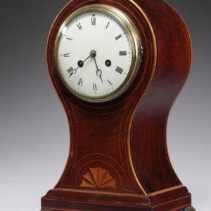 EDWARDIAN MAHOGANY BALLOON SHAPED MANTEL CLOCK