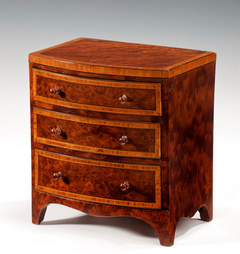 ANTIQUE AMBOYNA MINIATURE CHEST OF DRAWERS