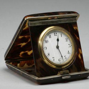 ANTIQUE TORTOISESHELL AND SILVER TRAVEL CLOCK