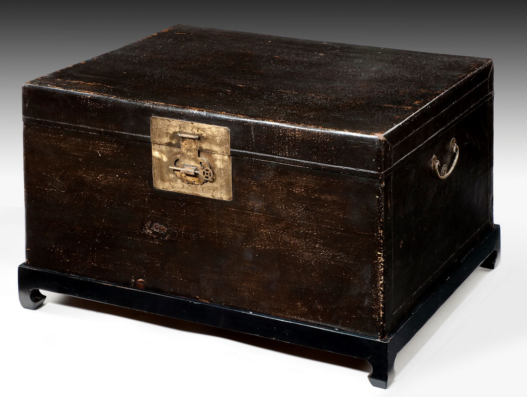 antique chinese black leather trunk on stand