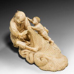 JAPANESE IVORY OKIMONO OF A FISHERMAN