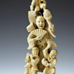 ANTIQUES JAPANESE IVORY OKIMONO OF A MAN CHILDREN AND MONKEY