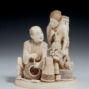 ANTIQUE JAPANESE IVORY OKIMONO OF BASKET SELLERS